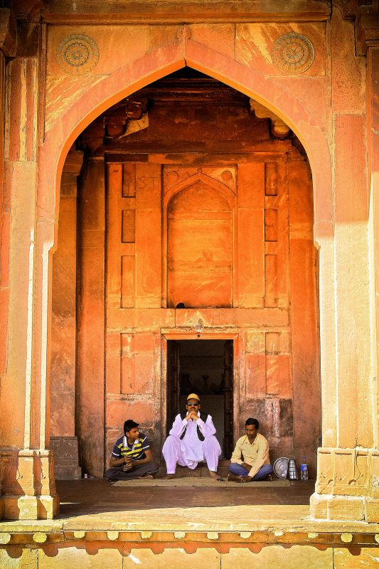 Men indulge in a chit-chat at one of the doors of Agra Fort.