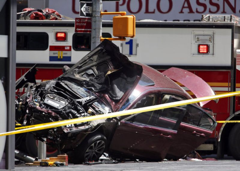 Car plowed into pedestrians on the sidewalk, killing one and injuring about 20 others, authorities and witnesses said.