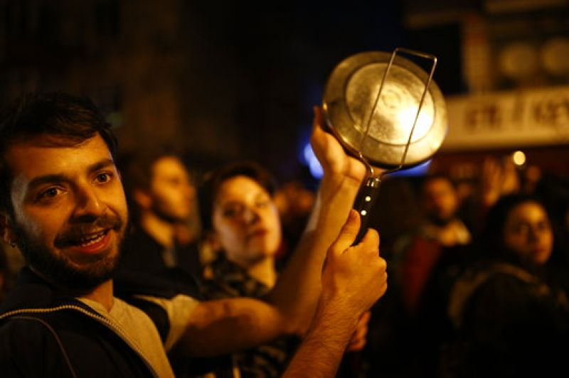 In homes lining the route of the protest, people bashed pots and pans with kitchen utensils from the windows of their apartments to show solidarity.