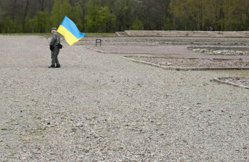 Nazi concentration camp survivor Petro Fedorowitsch Mischuk of Ukraine walks with a Ukrainian flag along the camp ground during the commemoration ceremonies for the 72th anniversary of the liberation of the former Nazi concentration camp Buchenwald near Weimar, Germany