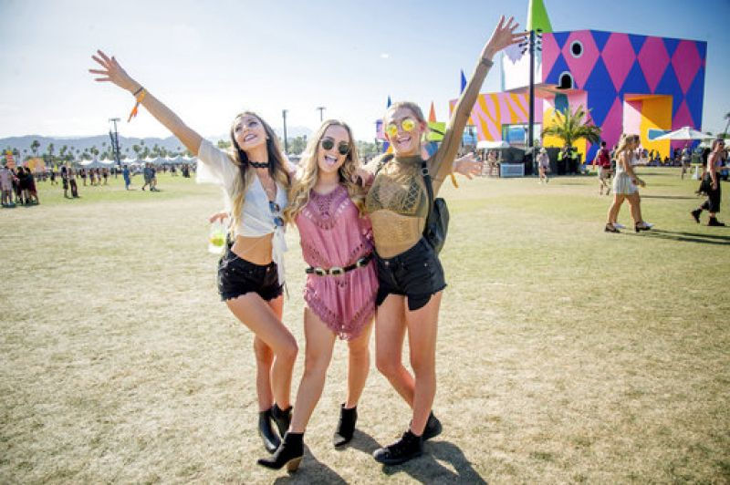Festival goers Autumn Mosley, from left, Cortlyn Morales and Cary Gutin pose at Coachella Music & Arts Festival at the Empire Polo Club. (Photo: AP)