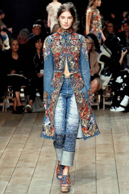 On international runways, floral appliques like this sensational, head-to-toe number by Alexander McQueen is adding to the popularity of the trend