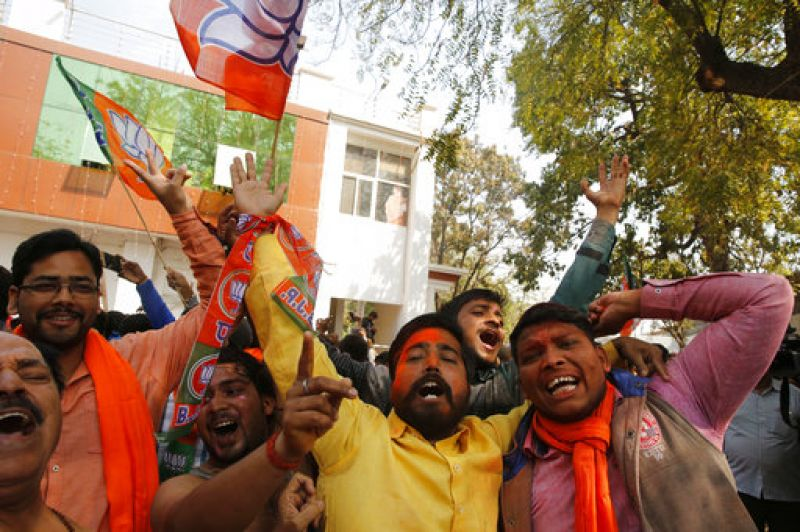 BJP supporters celebrate the victory at BJP Karyalay for leading to achieve most of the seats in Lucknow.