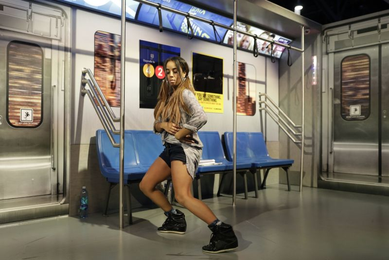 A model dances at a camera testing display at the Panasonic booth during CES International, Friday, Jan. 6, 2017, in Las Vegas. (AP Photo/John Locher)