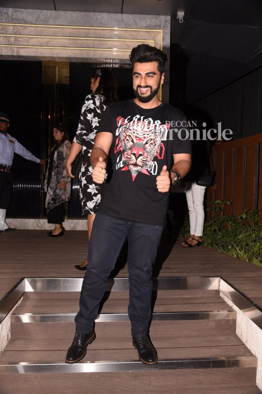 Arjun Kapoor smiles for the cameras.