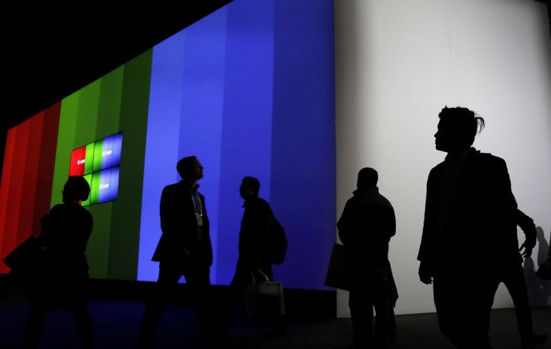 Attendees walk through the Samsung booth during CES International, Friday, Jan. 6, 2017, in Las Vegas. (AP Photo/John Locher)