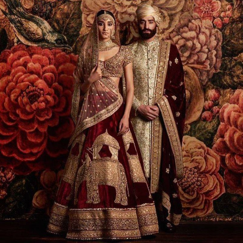 The lehenga for the bride and the Sherwani for the groom in India.