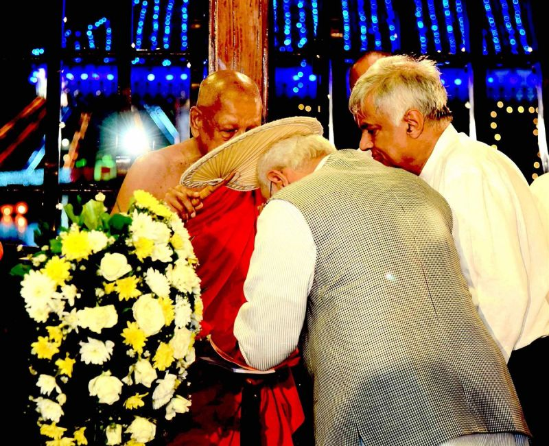 Prime Minister Narendra Modi being blessed by the priest at Seema Malaka Temple, in Colombo on Thursday.