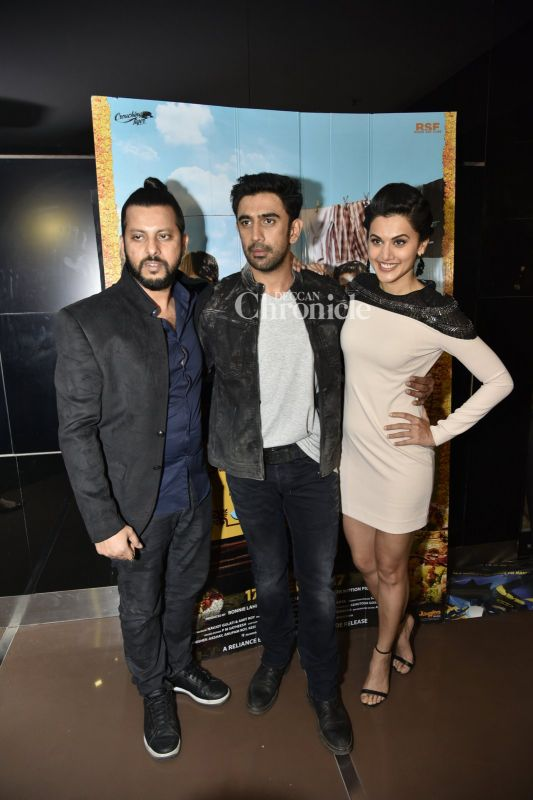 Amit and Taapsee pose along with their director Amit Roy.