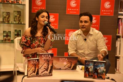 Alia addresses the audiences and the media at the event.