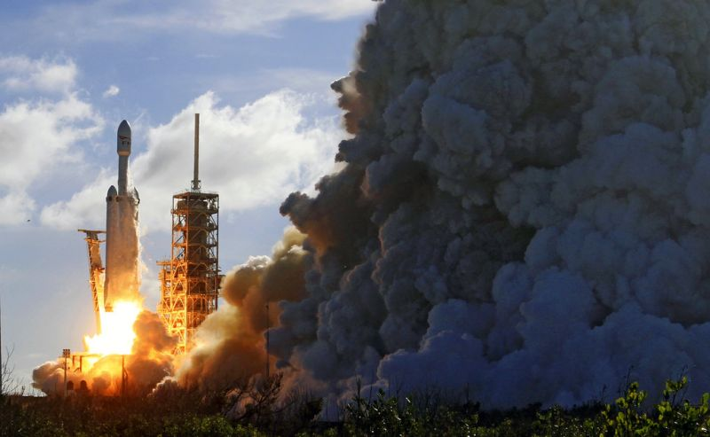 A Falcon 9 SpaceX heavy rocket lifts off from pad 39A at the Kennedy Space Center in Cape Canaveral, Fla.
