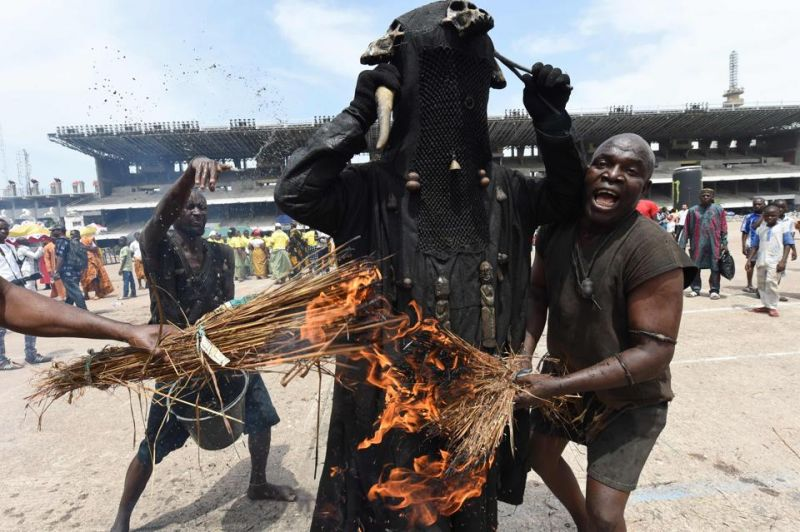 People wearing costumes perform during a carnival to mark 50 month-long celebrations in Lagos.