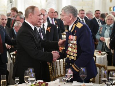 Russian President Vladimir Putin on Tuesday told the annual Victory Day parade on Red Square that the horrors of World War II demonstrate the necessity of countries working together to prevent war. He also met with WWII veteran, Hero of the Soviet Union, Sergei Kramarenko, during the Victory Day reception.