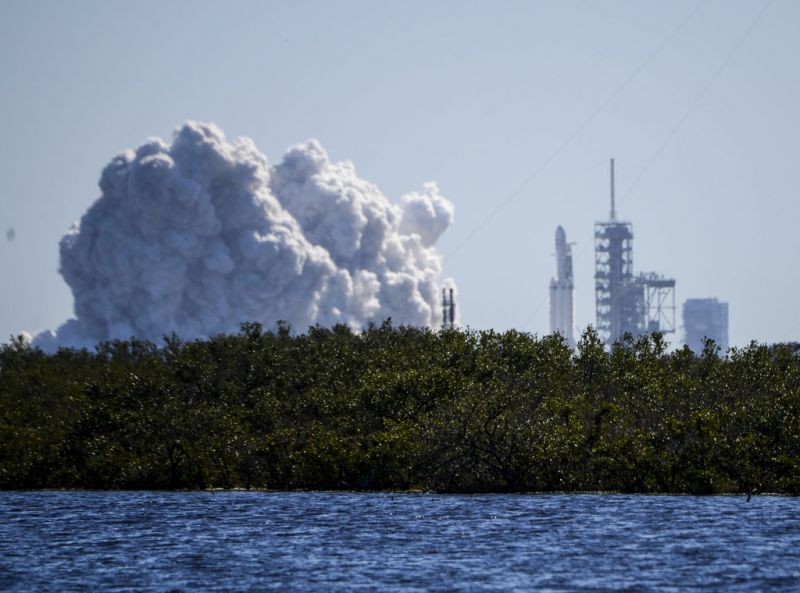 SpaceX fired up its newest, biggest rocket in a critical launch pad test. The Falcon Heavy briefly roared to life for the first time at NASA's Kennedy Space Center. All three boosters — 27 engines in all — were tested.