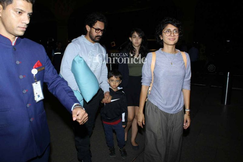 Aamir was snapped arriving at the airport along with his wife Kiran and children Azad and Ira.