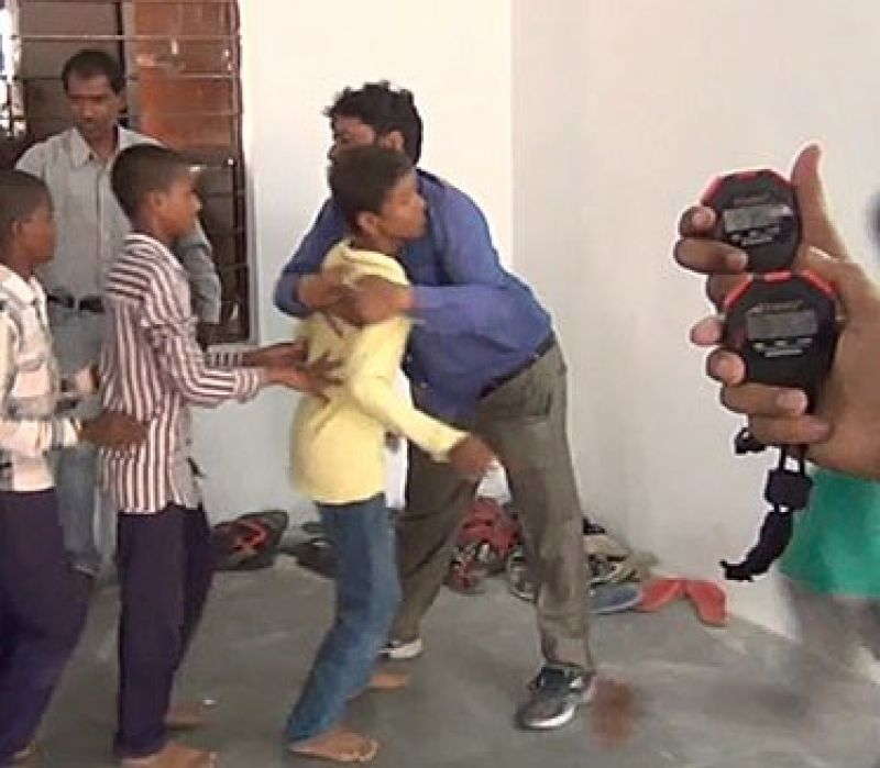 Perhaps the most affectionate man in India, Krishna Kumar from Hyderabad went on a rather peculiar hugging spree as he embraced 79 people in one minute to enter record books (Photo: YouTube)
