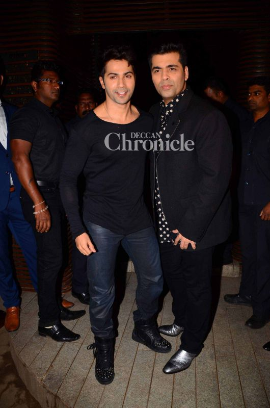 Varun Dhawan poses with his mentor and producer of the film Karan Johar.