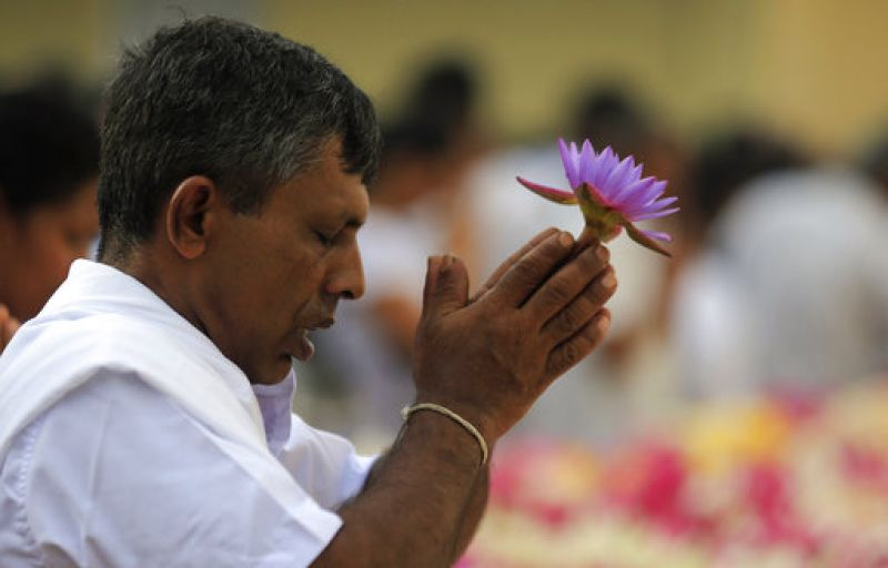 A Sri Lankan Buddhist devotee prays as he takes part in religious observances at a temple to mark Buddha Purnima.