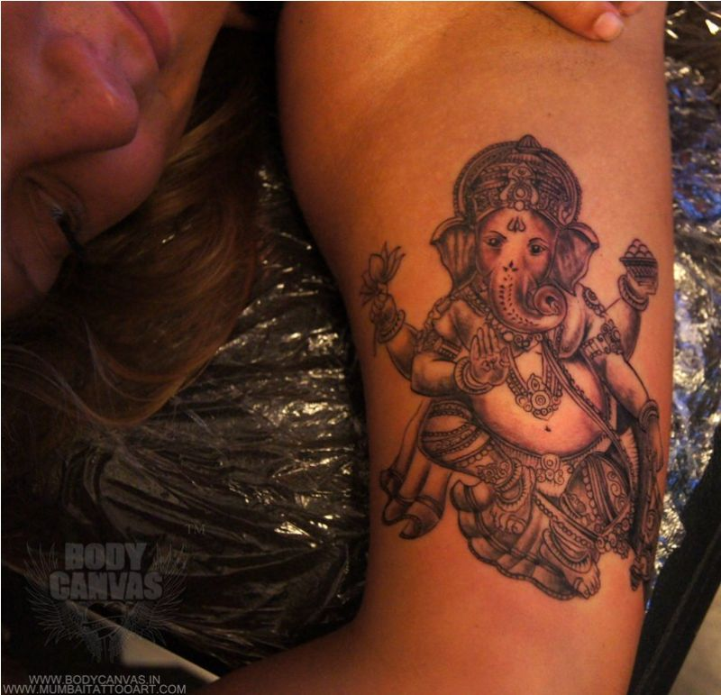 An ethnic idol etched on the skin.