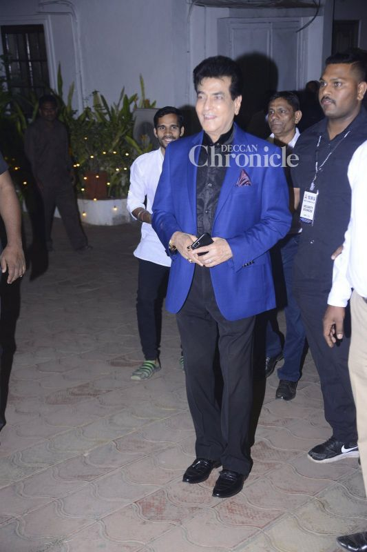 Jeetendra smiles for the cameras.