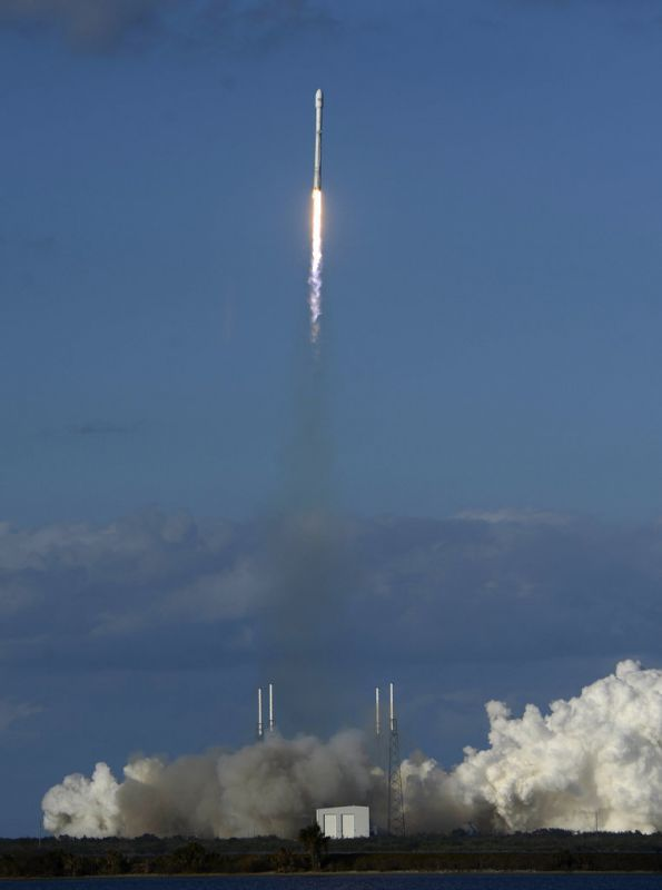 A Falcon 9 SpaceX heavy rocket lifts off from pad 39A. The Falcon Heavy, has three first-stage boosters, strapped together with 27 engines in all.