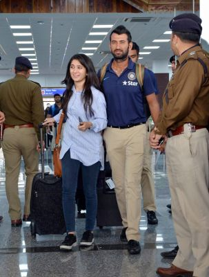 Cheteshwar Pujara, who jumped world no. 2 in the ICC Test Rankings, arrived with his wife Puja Pabari at the Kangra Airport in Dharamshala, ahead of the fourth Test between India and Australia. (Photo: PTI)