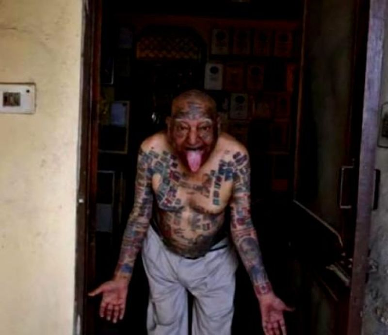 A man obsessed with setting Guinness world records got 366 flags tattooed on his body and had all his teeth removed so he could put nearly 500 drinking straws and more than 50 burning candles in his mouth. Har Parkash Rishi, who claims to have set more than 20 records, now calls himself Guinness Rishi (Photo: YouTube)