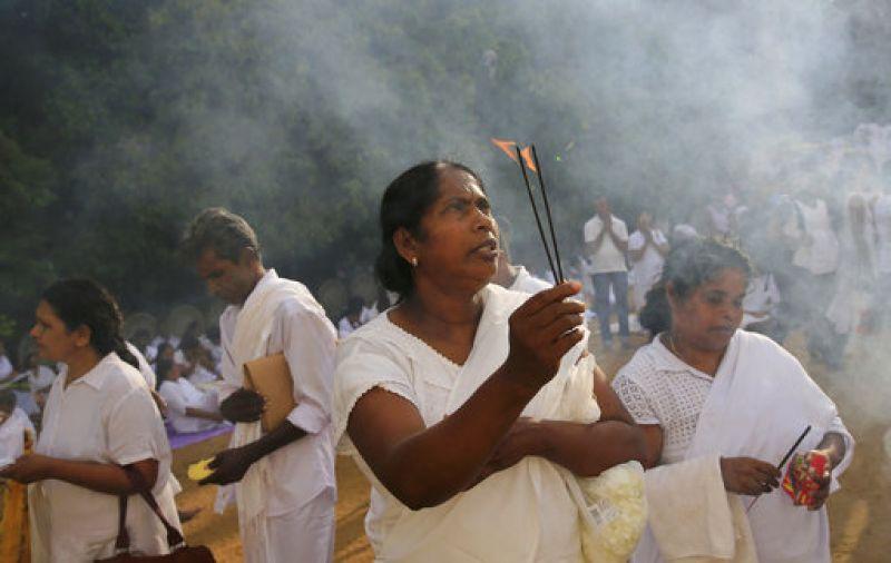 A Sri Lankan Buddhist devotee offers prayers at a temple to mark Buddha Purnima.