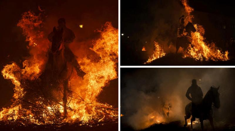 Many Spanish residents took to the streets on January 16 to ride their horses through bonfire flames as part of a planned display that got its start several centuries ago.