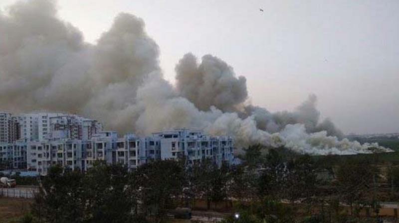 Thick smoke enveloped Bellandur lake after a fire broke out when garbage strewn around it was set ablaze.