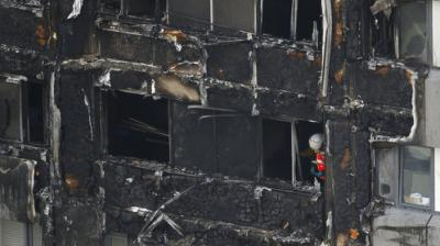 A massive fire ripped through a 27-storey apartment block in west London in the early hours of Wednesday, trapping residents inside as 200 firefighters battled the blaze.