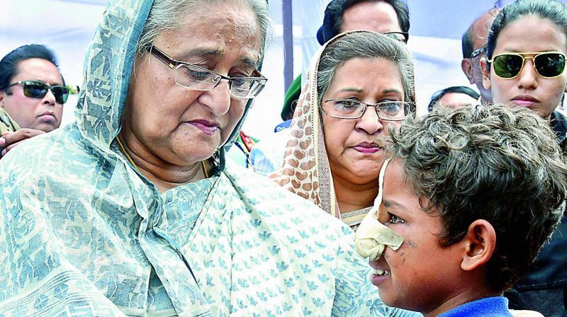Bangladeshi Prime Minister Sheikh Hasina meets a Rohingya Muslim child at Kutupalong refugee camp in Bangladesh on Tuesday. (Photo: AP)