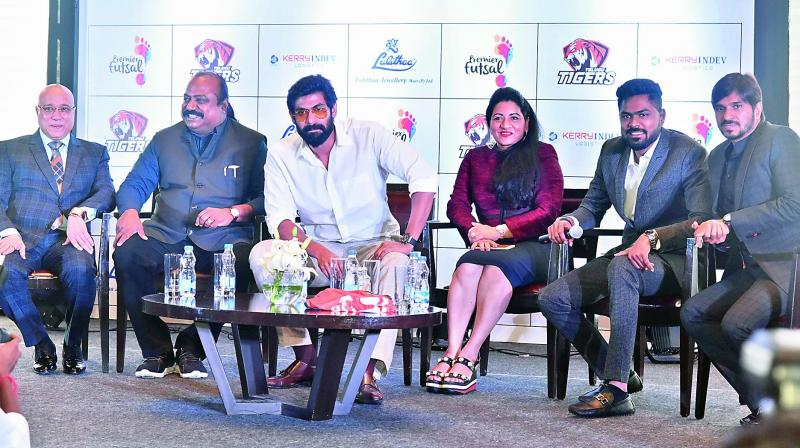 Actor Rana Daggubati (centre) at a press conference to launch Telugu Tigers as businessman Kiran Kumar (left), Premier Futsal League chairman Xavier Britto (second from left) and vice-chairman Vimala Britto look on.	 (Photo: DC)