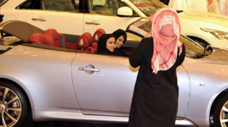 Woman Sharia Drive Cars