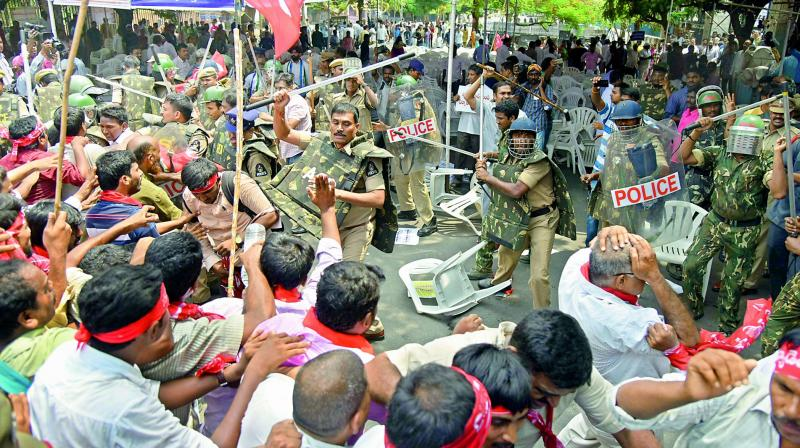 Cops use lathis to chase away protesters during the 'Chalo Indira Park' rally in Hyderabad on Monday. (Photo: DC)