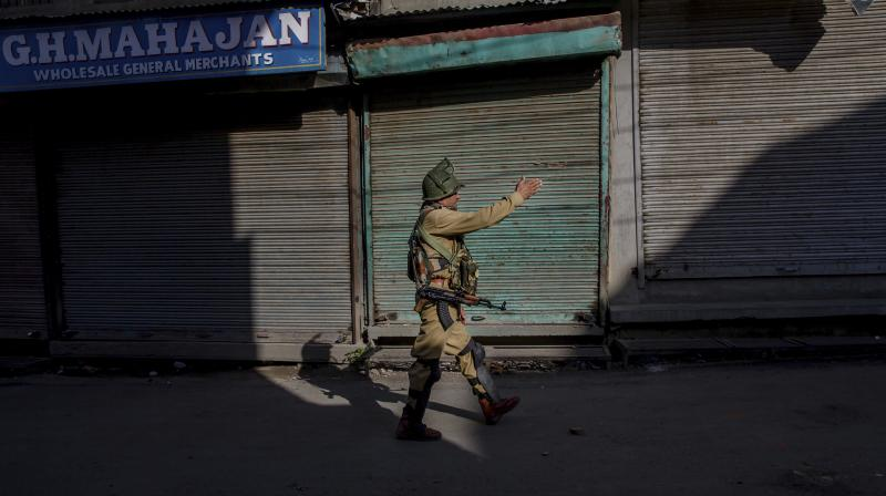 """Kashmir and parts of Chenab valley of Jammu region were shut on Saturday to protest against alleged """"devious attempts"""" being made at the behest of Sangh Parivar to abrogate Article 35A and Article 370 of the Constitution. (Photo: AP)"""