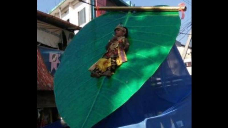 A photograph of a 3-year-old child dressed as Lord Krishna clicked during a procession in Payyannur on Tuesday has sparked outrage in the Kerala. (Photo: Facebook: Sreekanth Usha Prabhakaran)