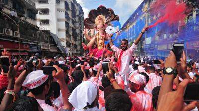 Thousands throng to Mumbai's streets as the city's favourite Lord Ganesha is taken amidst long processions to be immersed. (Photo: Debasish Dey)