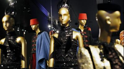 """The museum has a rotating exhibitions of Mr. Saint Laurent's couture, including such memorable pieces as the 1965 Mondrian dresses, Cossack-style brocade coats from the 1976 Ballets Russes collection, and the 1988 van Gogh """"Sunflowers"""" jacket (Photo: AP)"""
