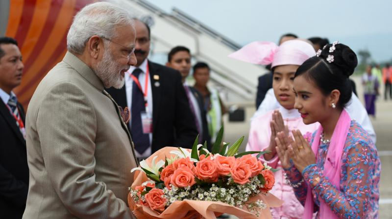 Prime Minister Narendra Modi being welcomed on his arrival at Nay Pyi Taw International Airport Myanmar on Tuesday