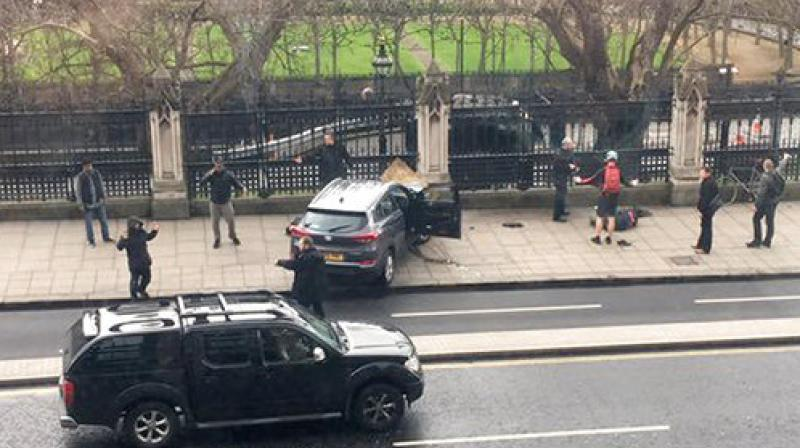 Police release man and woman questioned over Westminster attack