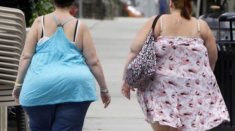 Immune cells prevalent in the fatty tissue get reduced in number which may contribute to cause diabetes and hypertension. (Photo: AP)