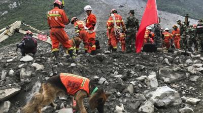 Chinese crews recovered nine bodies and were still searching for 109 others on Sunday, , a day after a massive landslide buried a picturesque mountain village in China.