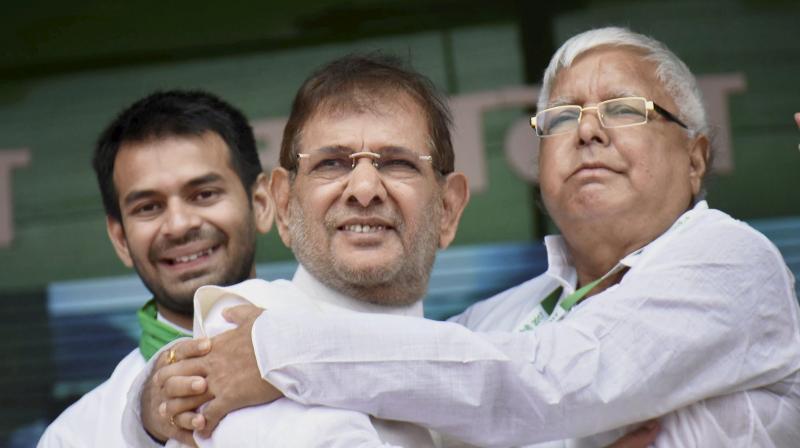 RJD chief Lalu Prasad Yadav with rebel Janata Dal-United (JD-U)