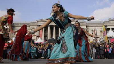 Celebrating its 16th anniversary, the Diwali Festival attracts over 35,000 people with its lively music and dance performances. photo: AP)