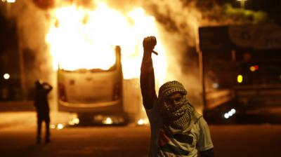 Protesters lit buses on fire, blocked roads and clashed with police on Friday during a general strike in Brazil.