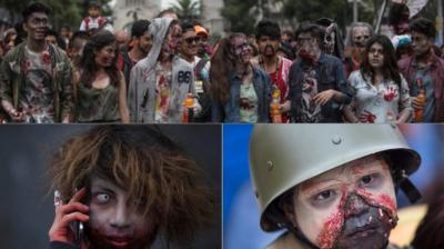 Hundreds dressed in rags and ghoulish makeup to look bloody and decaying, gathered in the historic center of Mexico's capital (Photo: AP)