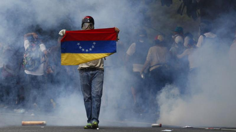 Two days of huge protests on the streets of Caracas against the socialist government of President Nicolas Maduro spilled into a violent Thursday night in several parts of the city. At least 20 people have been killed so far.
