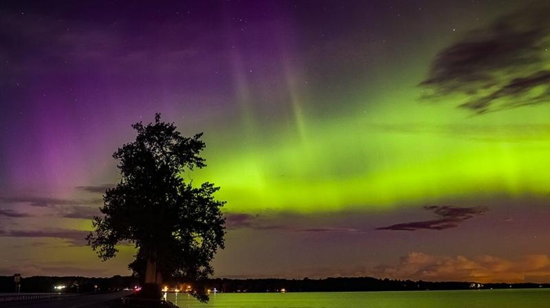 The Northern Lights are a result of collisions between electrically charged particles from the sun that enter the Earth's atmosphere. (Photo: Mark Tarello/Twitter)