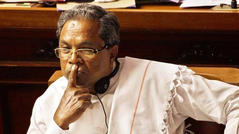The BJP workers blocked Siddaramaiah's official vehicle and waved black flags at him, demanding waiver for farmers' loans. (Photo: File)